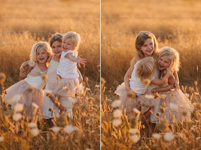 little girls hugging in field, sunkissed blonde girls, family portraits at sunset