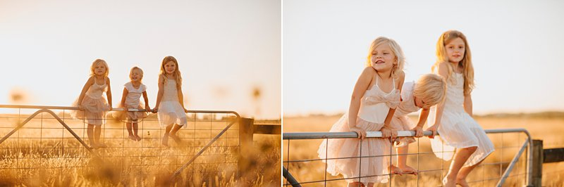 girls on a gate, rustic family portrait, sunkissed girls on gate