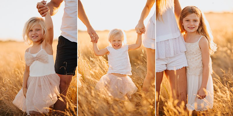 little girls holding parents hands, walking portrait of children family portraits at sunset