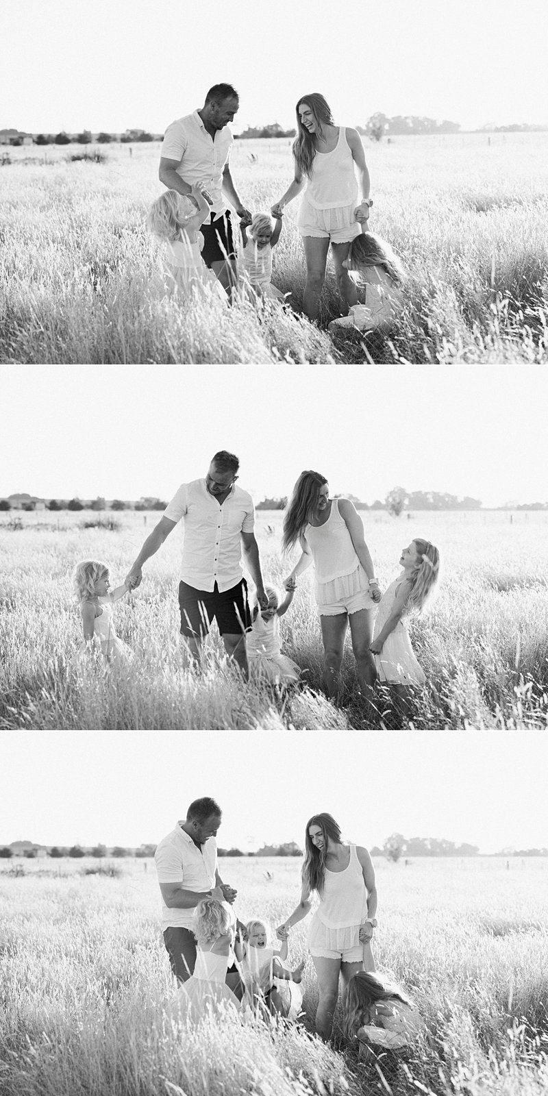 bw family portrait in paddock, walking family portrait