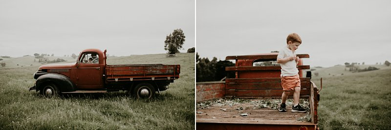 old bedford truck; farm kids; rustic tones family shoot; extended family portraits; grandparents; grandkids; family farm