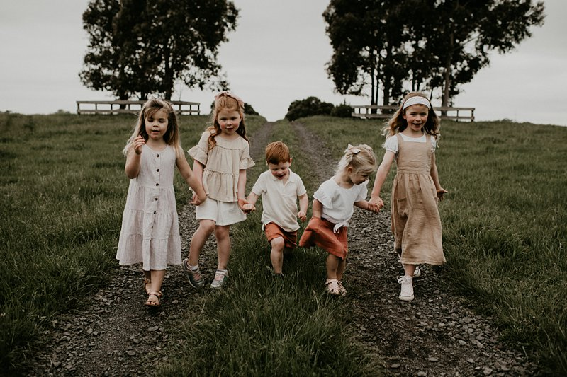 farm kids; rustic tones family shoot; extended family portraits; grandkids; family farm walking portrait
