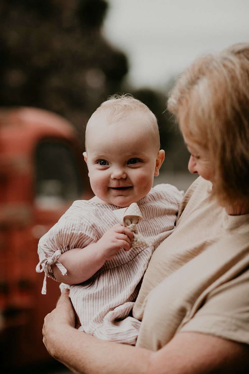 old bedford truck; farm kids; rustic tones family shoot; extended family portraits; grandkids; family farm