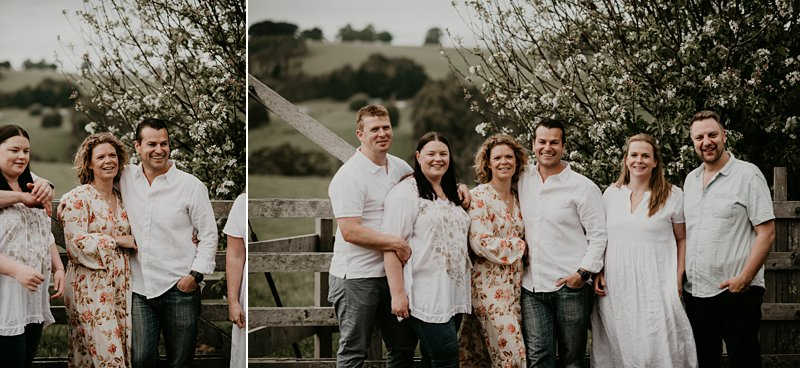 farm kids; rustic tones family shoot; extended family portraits; grandkids; family farm blossoms; old rustic gate